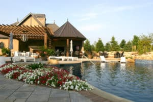 Custom Pool, poolhouse, outdoor bar environment